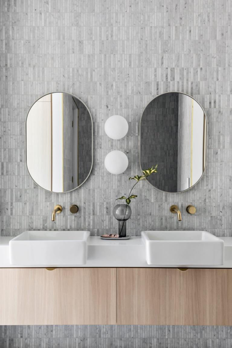 Carrara stone stax on bathroom wall